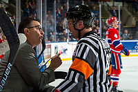 KELOWNA, BC - MARCH 13: Spokane Chiefs' head coach Dan Lambert stands on the bench and speaks to referee Jeff Ingram against the Kelowna Rockets at Prospera Place on March 13, 2019 in Kelowna, Canada. (Photo by Marissa Baecker/Getty Images)