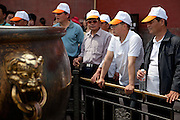 "Members of a Chinese tourist group inside  ""The Forbidden City"" which was the Chinese imperial palace from the Ming Dynasty to the end of the Qing Dynasty. It is located in the middle of Beijing, China. Beijing is the capital of the People's Republic of China and one of the most populous cities in the world with a population of 19,612,368 as of 2010."