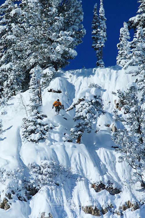 Skier jumping off a cliff at Alta Ski Resort