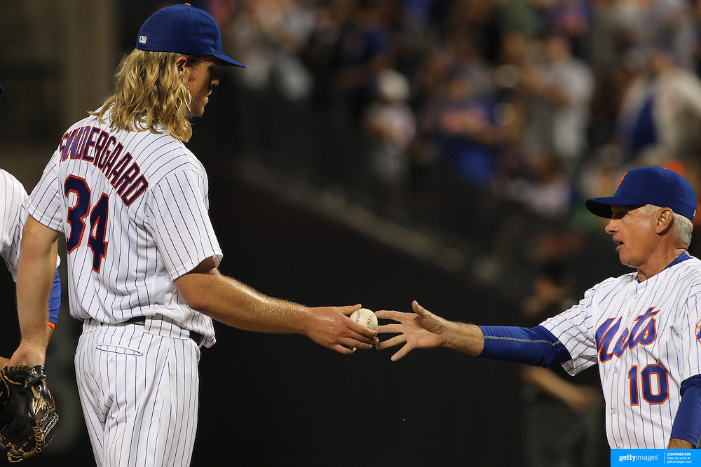 NEW YORK, NEW YORK - June 15: Pitcher Noah Syndergaard #34 of the New York Mets hands the ball to Manager Terry Collins after being pulled from the game in the ninth inning during the Pittsburgh Pirates Vs New York Mets regular season MLB game at Citi Field on June 15, 2016 in New York City. (Photo by Tim Clayton/Corbis via Getty Images)