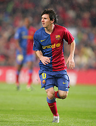 Lionel Messi of Barcelona in action during the UEFA Champions League quarter final first leg match between FC Barcelona and FC Bayern Munich at the Camp Nou stadium on April 8, 2009 in Barcelona, Spain.