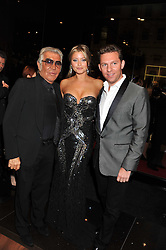 Left to right, ROBERTO CAVALLI, HOLLY VALANCE and NICK CANDY at a party hosted by Roberto Cavalli to celebrate his new Boutique's opening at 22 Sloane Street, London followed by a party at Battersea Power Station, London SW8 on 17th September 2011.