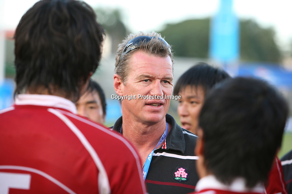John Kirwan, coach of Japans rugby team, talks to his during the match between Japan and Fiji at the Pacific Nations Cup, 3 July 2009. Photo: Bruce Southwick/PHOTOSPORT