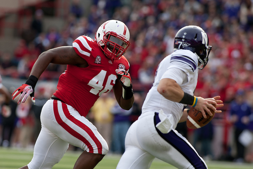 05 November 2011: Eric Martin #46 of the Nebraska Cornhuskers pursues Dan Persa #7 of the Northwestern Wildcats in the second quarter at Memorial Stadium in Lincoln, Nebraska.  Northwestern defeated Nebraska 28 to 25.