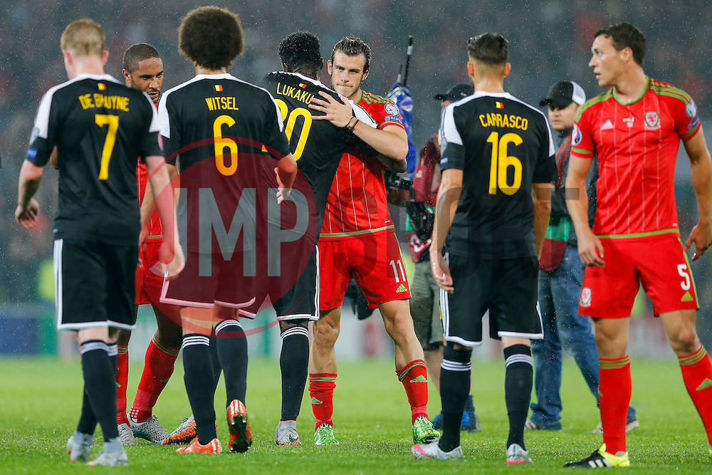 Goalscorer Gareth Bale of Wales (Real Madrid) hugs Romelu Lukaku of Belgium (Everton) after Wales win the match 1-0 to top their UEFA2016 Qualifying Group - Photo mandatory by-line: Rogan Thomson/JMP - 07966 386802 - 12/06/2015 - SPORT - FOOTBALL - Cardiff, Wales - Cardiff City Stadium - Wales v Belgium - EURO 2016 Qualifier.
