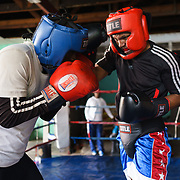 Siyakudumisa Vapi (right), a licensed boxer hoping to make it as a professional, sparring at the Hillbrow Boxing Club in Johannesburg, South Africa. Vapi is training for a fight against the third-ranked fighter in the national featherweight division; if he wins it will bring him closer to his objective of challenging for the national title, and being able to make a decent living from boxing. Vapi says boxing pulled him away from the streets and bad company, and gave him discipline.