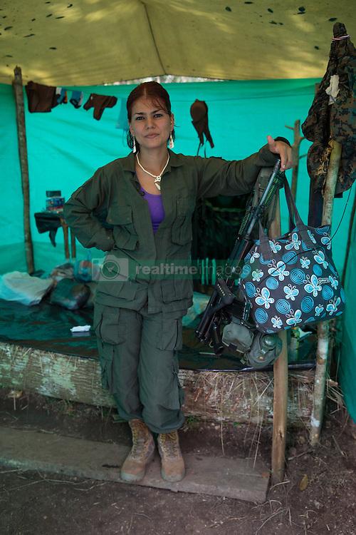 El Diamante, Meta, Colombia - 18.09.2016        <br /> <br /> Guerilla camp during the 10th conference of the marxist FARC-EP in El Diamante, a Guerilla controlled area in the Colombian district Meta. Few days ahead of the peace contract passing after 52 years of war with the Colombian Governement wants the FARC decide on the 7-days long conferce their transformation into a unarmed political organization. <br /> <br /> Guerilla-Camp zur zehnten Konferenz der marxistischen FARC-EP in El Diamante, einem von der Guerilla kontrollierten Gebiet in der kolumbianischen Region Meta. Wenige Tage vor der geplanten Verabschiedung eines Friedensvertrags nach 52 Jahren Krieg mit der kolumbianischen Regierung will die FARC auf ihrer sieben taegigen Konferenz die Umwandlung in eine unbewaffneten politischen Organisation beschlieflen. <br />  <br /> Photo: Bjoern Kietzmann