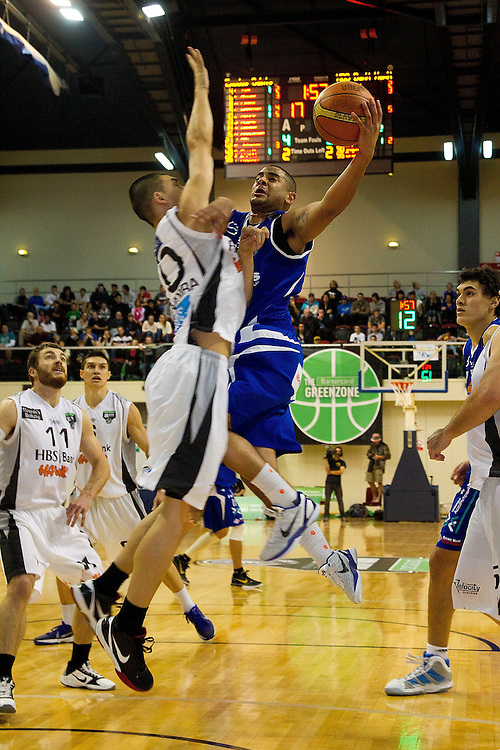 Wellington Saints Corey Webster is blocked by Hawkes Bay Hawks Morgan Natanahira at the NBL Grand final at the TSB Arena, Wellington, New Zealand, Sunday, July 17, 2011. Credit:SNPA/Marty Melville