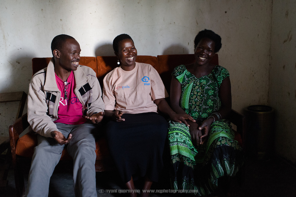 Moses Opolot of Plan Uganda; Lovisa Wankya, and Afripads Dealer, and Mary Abbo, Margaret Kigeni's mother at Mary's home near Tororo, Uganda on 1 August 2014.