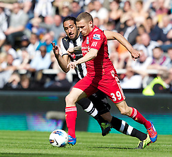 NEWCASTLE-UPON-TYNE, ENGLAND - Sunday, April 1, 2012: Liverpool's Craig Bellamy in action against Newcastle United's captain Jonas Gutierrez during the Premiership match at St James' Park. (Pic by Vegard Grott/Propaganda)