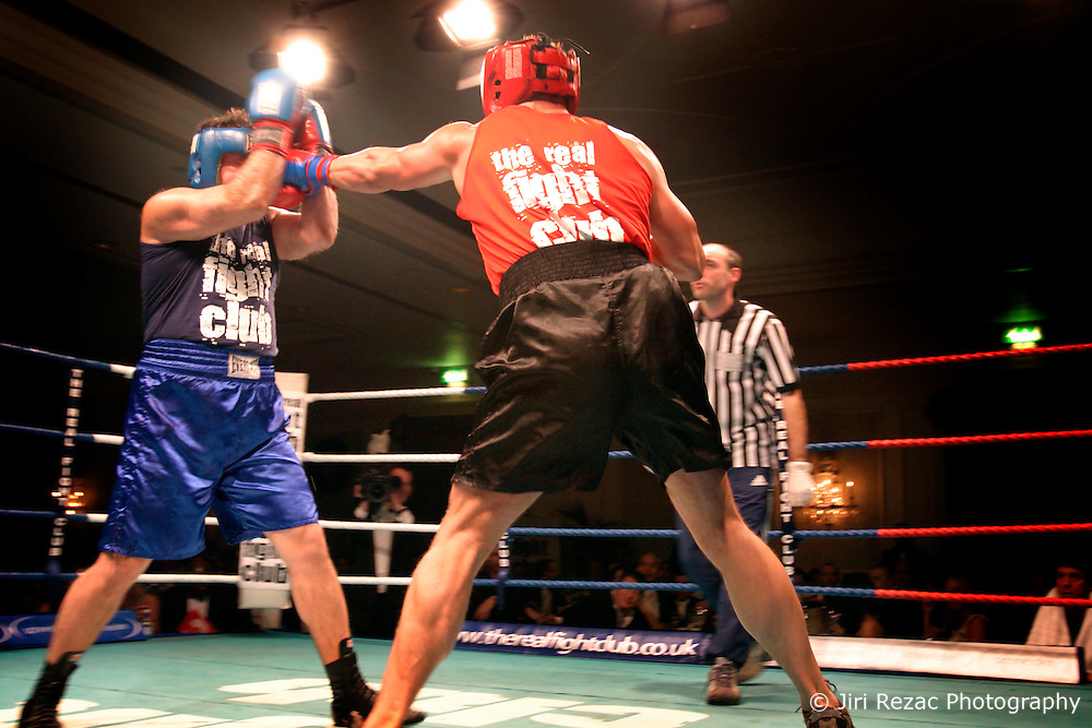 UK ENGLAND LONDON 2DEC04 - Boxers John Partridge (Blue) and Justin Floyd trade punches during the 4th Real Fight Club City Broker Christmas Bash at the London Mariott Hotel, Mayfair. The high-adrenaline contact sport of White Collar Boxing originated in New York 17 years ago and attracts mostly young males from the financial, legal and medical professions...jre/Photo by Jiri Rezac ....© Jiri Rezac 2004....Contact: +44 (0) 7050 110 417..Mobile:  +44 (0) 7801 337 683..Office:  +44 (0) 20 8968 9635....Email:   jiri@jirirezac.com..Web:    www.jirirezac.com....© All images Jiri Rezac 2004 - All rights reserved.