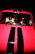 Two girls sat in their Mini car, Girlracers, Southend, UK 2004