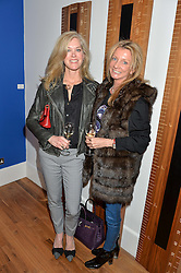 Left to right, HOLLY TELLING and SANDRA DRAPER at a party to celebrate the 30th anniversary of Linley held at Linley, 60 Pimlico Road, London on 3rd May 2016.