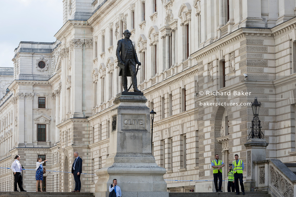 The Foreign Office in King Charles Street is blocked as Westminster experiences a lockdown with extensive cordons and the closure of many streets after what police are calling a terrorist incident in which a car was crashed into security barriers outside parliament in central London, on 14th August 2018, in London, England.
