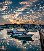 Boats in Nachikatsuura harbor at sunset, Kii Peninsula, Wakayama Prefecture, Japan. This image was stitched from multiple overlapping photos.