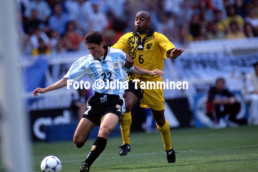 FIFA World Cup - France 1998<br /> 21.6.1998, Parque des Princes, Paris, France.<br /> Group H, Argentina v Jamaica.<br /> Javier Zanetti (Argentina) v Fitzroy Simpson (Jamaica).
