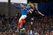 Ronan Curtis and Niall Mason compete for the ball during the EFL Sky Bet League 1 match between Portsmouth and Peterborough United at Fratton Park, Portsmouth, England on 7 December 2019.