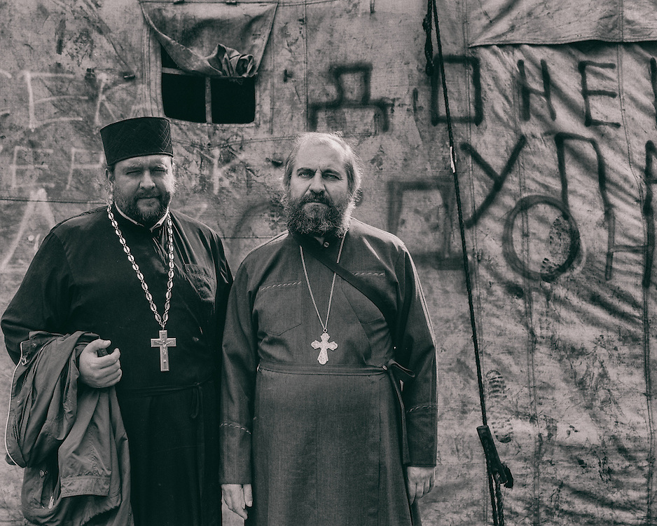 Ukraine - Kyiv - 19 May 2014 - Two orthodox priests offering their services to people on Maidan place.