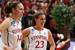 March 21, 2011; Stanford, CA, USA; Stanford Cardinal forward Kayla Pedersen (14) and guard Jeanette Pohlen (23) after the game during the second round of the 2011 NCAA women's basketball tournament against the St. John's Red Storm at Maples Pavilion. Stanford defeated St. John's 75-49.