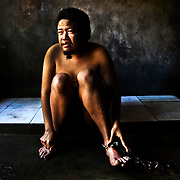 "Bali, Indonesia. Mental diseases in paradise. The Balinese community doesn't accept the existance of this illness. Famillies and people are not well informed and ready to face the disease. Ketut, 32 years old. Schizophrenic for 5 years, in ""prison"" since 4. He lives naked, he doesn't want clothes, he rips them off as soon as his father tried to put them on him"