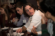 """Nathan Kocan participates in conversation during the Ohio University Homecoming """"Dinner with 12 Strangers"""" event at Sol on Oct. 8, 2014. Photo by Lauren Pond"""