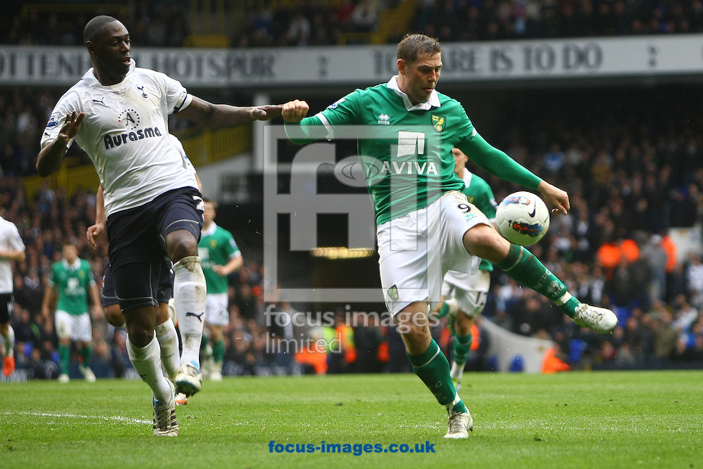 Picture by Paul Chesterton/Focus Images Ltd.  07904 640267.09/04/12.Grant Holt of Norwich and Ledley King of Spurs in action during the Barclays Premier League match at White Hart Lane Stadium, London..