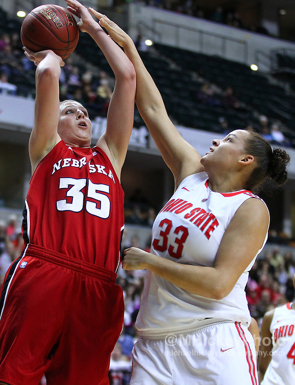 March 03, 2012; Indianapolis, IN, USA; Nebraska Cornhuskers forward Jordan Hooper (35) shoots the ball against Ohio State Buckeyes center Ashley Adams (33) during the semifinals of the 2012 Big Ten Tournament at Bankers Life Fieldhouse. Mandatory credit: Michael Hickey-US PRESSWIRE