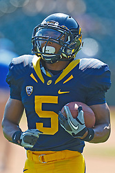 September 17, 2011; San Francisco, CA, USA;  California Golden Bears running back Brendan Bigelow (5) warms up before the game against the Presbyterian Blue Hose at AT&T Park.  California defeated Presbyterian 63-12.
