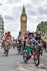 © Licensed to London News Pictures. 29/07/2017. London, UK. Members of the public ride through Parliament Square during the Prudential RideLondon FreeCycle, around an 8 mile course in the centre of the capital, taking in in iconic landmarks en route.  The event is part of Prudential RideLondon's three day celebration of cycling with over 100,000 people participating over the weekend..   Photo credit : Stephen Chung/LNP