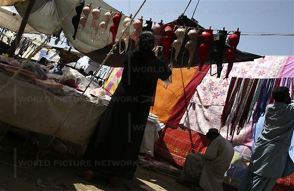 "A Pakistani Muslim woman shops bra at the stall of undergarment  at ""Sunday Bazar"" on Sunday 25, 2007 in Karachi, Pakistan..Pakistan most known as an Islamic Taliban and lake of tolerant, certain youths from the middle class and upper class is finding its way out, one foot in tradition and the other in western way of life."