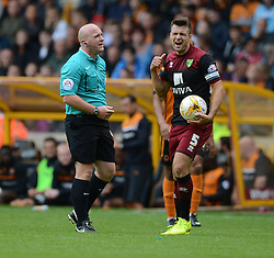 Norwich City's Russell Martin complains to the ref after getting a yellow. - Photo mandatory by-line: Alex James/JMP - Mobile: 07966 386802 10/08/2014 - SPORT - FOOTBALL - Wolverhampton - Molineux Stadium - Wolves v Norwich City - Sky Bet Championship