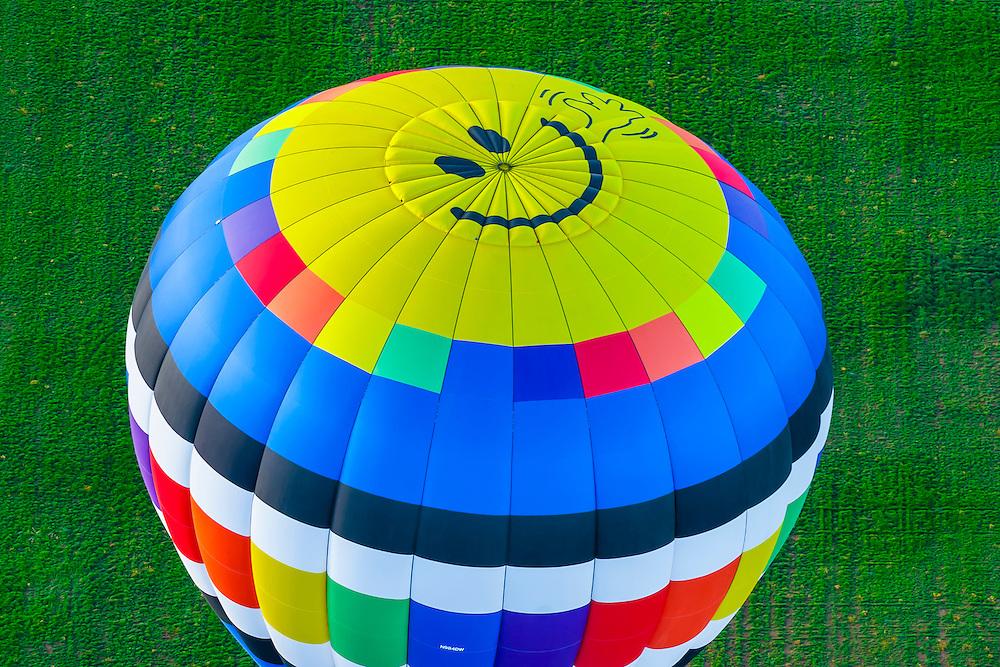 Aerial view of hot air balloon with happy face on top, Albuquerque International Balloon Fiesta, Albuquerque, New Mexico USA.