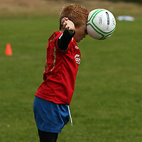 Eric Copley getting his head to it at the FAI summer soccer camp in Gallery Park in Kilrush during the week.<br /> Photograph by Yvonne Vaughan