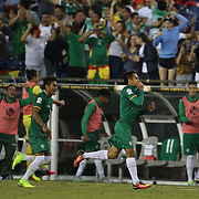 FOXBOROUGH, MASSACHUSETTS - JUNE 10:  Jhasmani Campos #10 of Bolivia celebrates with team mates after scoring a goal during the Chile Vs Bolivia Group D match of the Copa America Centenario USA 2016 Tournament at Gillette Stadium on June 10, 2016 in Foxborough, Massachusetts. (Photo by Tim Clayton/Corbis via Getty Images)