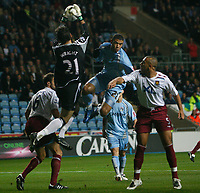 Photo: Steve Bond.<br /> Coventry City v West Ham United. Carling Cup. 30/10/2007. Keeper richard wright safely gathers under pressure from Leon Best