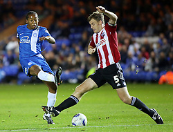 Peterborough United's Jaanai Gordon in action with Brentford's Tony Craig - Photo mandatory by-line: Joe Dent/JMP - Tel: Mobile: 07966 386802 08/10/2013 - SPORT - FOOTBALL - London Road Stadium - Peterborough - Peterborough United V Brentford - Johnstone's Paint Trophy