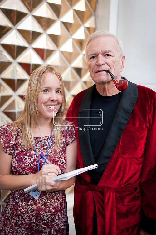 February 20th, 2012, Las Vegas, Nevada. The 21st Annual Reel Awards in Las Vegas where celebrity lookalikes show off their talents. Pictured is George Kane as Hugh Hefner with reporter Julie Moult..PHOTO © JOHN CHAPPLE / www.johnchapple.com.