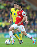 Mikel Arteta of Arsenal and Jonny Howson of Norwich in action during the Barclays Premier League match at Carrow Road, Norwich<br /> Picture by Paul Chesterton/Focus Images Ltd +44 7904 640267<br /> 11/05/2014