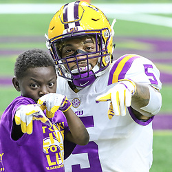 Sep 2, 2017; New Orleans, LA, USA; LSU Tigers running back Derrius Guice (5) poses with fan Jarrius Robertson before  the AdvoCare Texas Kickoff game against the Brigham Young Cougars at the Mercedes-Benz Superdome. Mandatory Credit: Derick E. Hingle-USA TODAY Sports