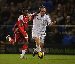 Bolton, England - Wednesday, January 31, 2007: Bolton Wanderers' Henrik Pedersen and Charlton Athletic's Osei Sankofa during the Premiership match at the Reebok Stadium. (Pic by David Rawcliffe/Propaganda)
