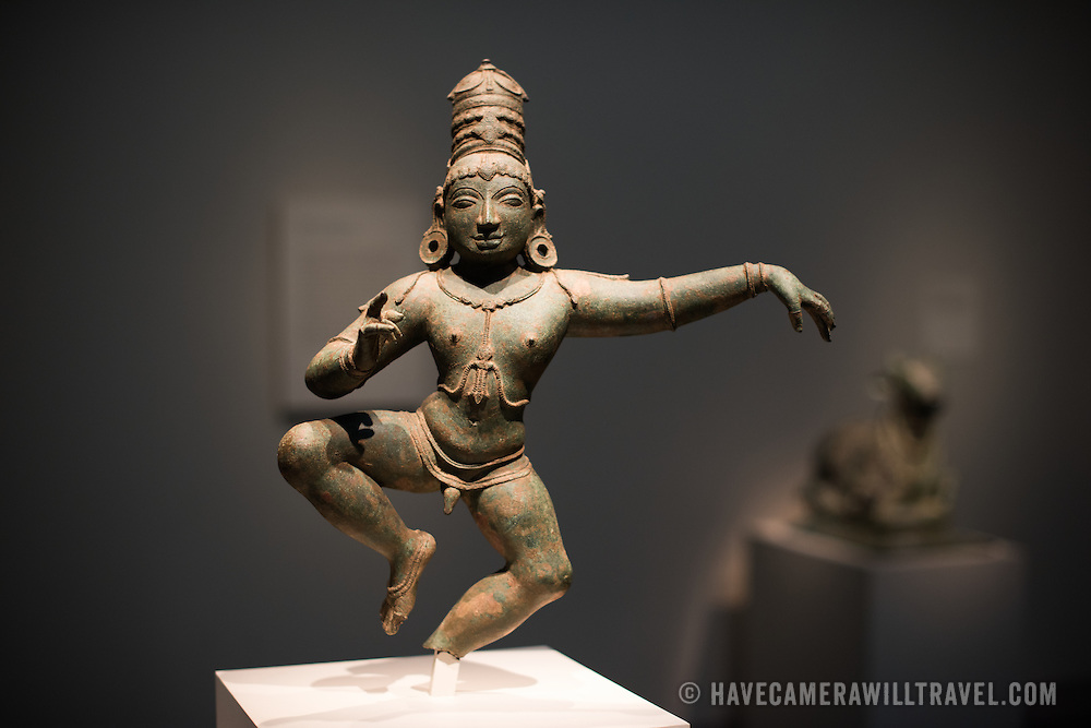 Child-saint Sambander, a bronze statuette from India, state of Tamil Nadu, Chola dynasty, and dated to teh 12th century.  Sculpture on display in an exhibit of Asian art in the Freer Gallery of Art in Washington DC. Sitting on the National Mall and part of the Smithsonian Institution, the Freer Gallery opened in 1923 to house the art collection of Charles Lang Freer. It has since been merged with the Arthur M. Sackler Gallery to form the National Museum of Asian Art for the United States of America.