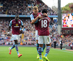 Aston Villa's Andreas Weimann celebrates his goal with Aston Villa's Kieran Richardson and Aston Villa's Aly Cissokho - Photo mandatory by-line: Joe Meredith/JMP - Mobile: 07966 386802 31/08/2014 - SPORT - FOOTBALL - Birmingham - Villa Park - Aston Villa v Hull City - Barclays Premier League