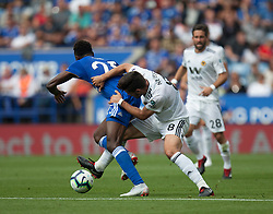 Wilfred Ndidi of Leicester City (L) is fouled by Ruben Neves of Wolverhampton Wanderers - Mandatory by-line: Jack Phillips/JMP - 18/08/2018 - FOOTBALL - King Power Stadium - Leicester, England - Leicester City v Wolverhampton Wanderers - English Premier League