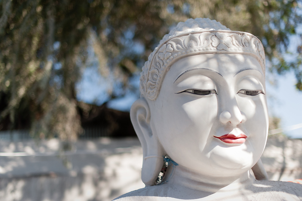 Buddha face in white marble