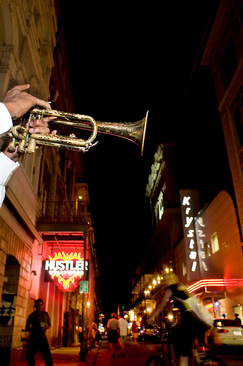 A trumpet player in a high school band plays big band music on Bourban St. in New Orleans, LA.