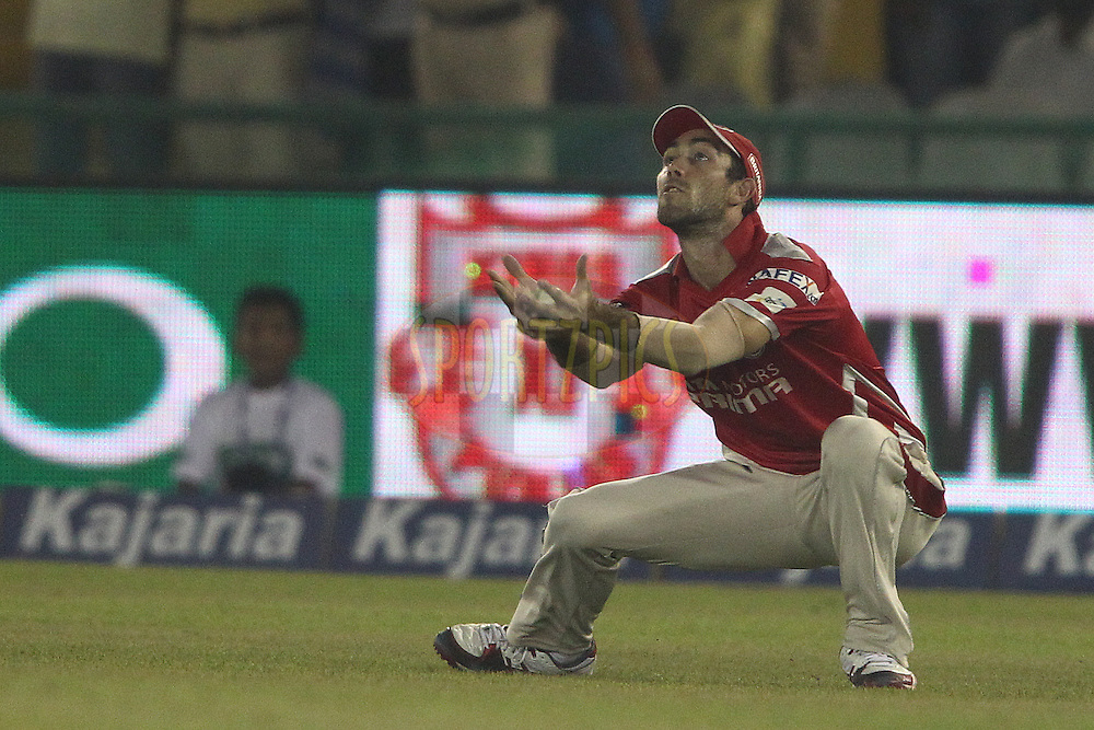 Glenn Maxwell of the Kings XI Punjab takes the catch to get Ben Dunk of the Hobart Hurricanes wicket during match 2 of the Oppo Champions League Twenty20 between the Kings XI Punjab and the Hobart Hurricanes held at the Punjab Cricket Association Stadium, Mohali, India on the 18th September 2014<br /> <br /> Photo by:  Shaun Roy / Sportzpics/ CLT20<br /> <br /> <br /> Image use is subject to the terms and conditions as laid out by the BCCI/ CLT20.  The terms and conditions can be downloaded here:<br /> <br /> http://sportzpics.photoshelter.com/gallery/CLT20-Image-Terms-and-Conditions-2014/G0000IfNJn535VPU/C0000QhhKadWcjYs