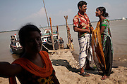 Asia, Bangladesh October 2012: Jorina, one of the sex worker in Bani Shanta, trying to get clients on a not very busy day..At the end she successed to take one client in her room. The prostitute in Bani Shanta are quite aggressive with the few man that are still coming on the island looking for sex..Bani Shanta, one of the 14 official brothels in Bangladesh, a Muslim nation where prostitution is considered legal, October 2012, ©GIULIO DI STURCO..