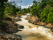 17 JUNE 2016 - DON KHONE, CHAMPASAK, LAOS:  Khon Pa Soi Waterfalls, on the east side of Don Khon. It's the smaller of the two waterfalls in Don Khon. Fishermen have constructed an elaborate system of rope bridges over the falls they use to get to the fish traps they set. Fishermen in the area are contending with lower yields and smaller fish, threatening their way of life. The Mekong River is one of the most biodiverse and productive rivers on Earth. It is a global hotspot for freshwater fishes: over 1,000 species have been recorded there, second only to the Amazon. The Mekong River is also the most productive inland fishery in the world. The total harvest of fish from the Mekong is approximately 2.5 million metric tons per year. By some estimates the harvest in the Tonle Sap (in Cambodia) had doubled from 1940 to 1995, but the number of people fishing the in the lake has quadrupled, so the harvest per person is cut in half. There is evidence of over fishing in the Mekong - populations of large fish have shrunk and fishermen are bringing in smaller and smaller fish.        PHOTO BY JACK KURTZ