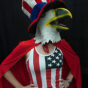 Cosplayer in her Freedom America costume with eagle mask and Uncle Sam Hat and American Flag shirt.<br />