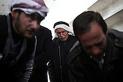 Men look to bodies in front of them to identify the victims of the army assault inside the mosque. On 22. February the syrian army attacked the village of Kureen, Province of Idlib, Syria. Kureen was among the first villages in the northwest of Syria controlled by the opposition. Some villagers and members of the defence units escaped to surrounding olive orchards, when the attack begun in the early morning. A majority of the inhabitants didn´t manage to escape. The heavy shelling lasts 7 houres. Soldiers searched all houses, burnt some of them down, loote shops, stole cars and furniture. About 60 motorcycles were burnt down. Tanks demolished several houses. 6 men were executed. One woman died as a result of an heart attack.